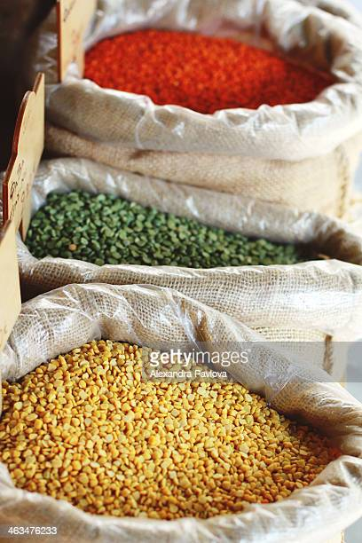 various types of colorful lentils at a market - alexandra pavlova stock pictures, royalty-free photos & images