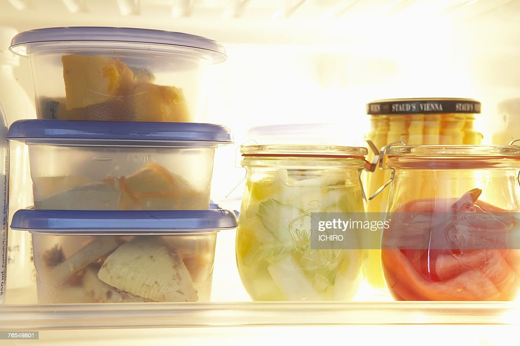 Various types of food in plastic container pots in refrigerator : Stock Photo