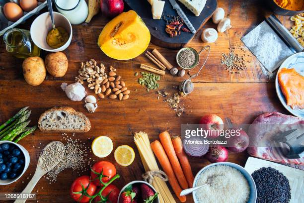 various types of food on wooden table - alimentazione sana foto e immagini stock
