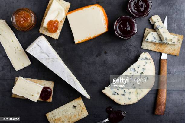 various types of french cheese with jam - クラッカー ストックフォトと画像