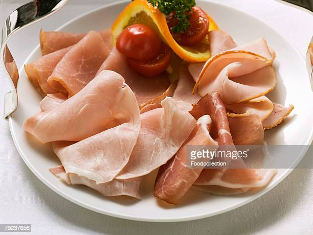 Various types of ham on a plate