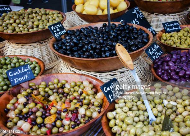 various types of olives for sale in market in france - kalamata olive stock photos and pictures