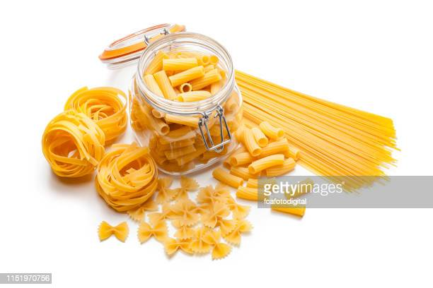 various types of raw pasta isolated on white background - pasta stock pictures, royalty-free photos & images