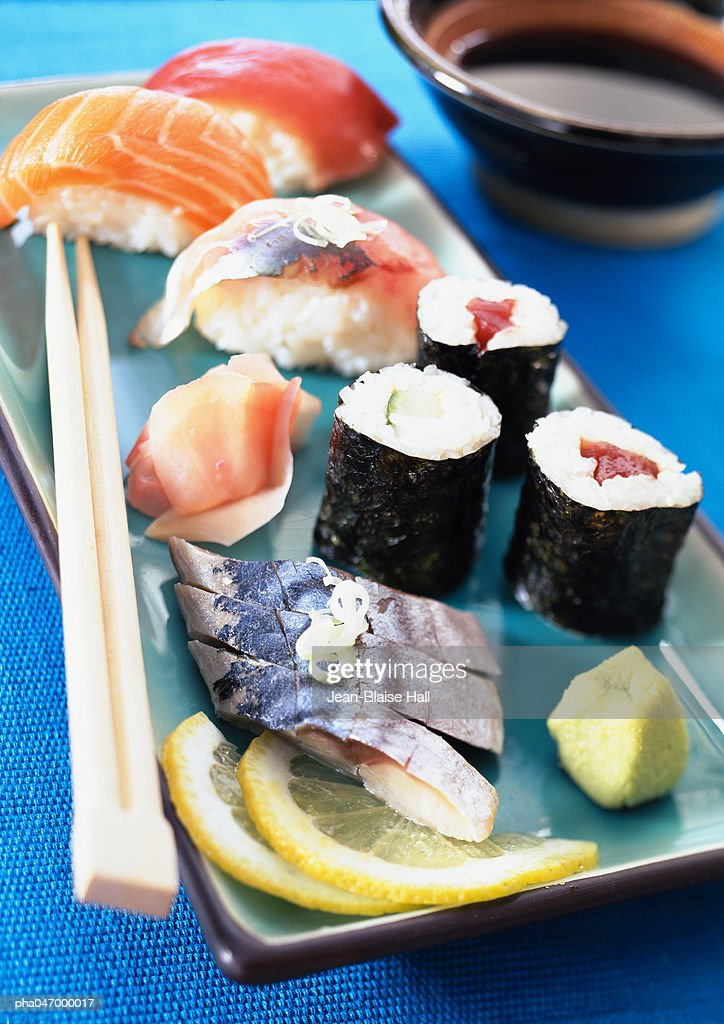 Various types of sushi on plate with chopsticks, close-up : Stockfoto