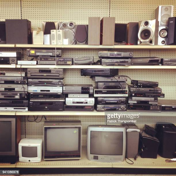 various used electronics on a shelf - obsolete stock pictures, royalty-free photos & images