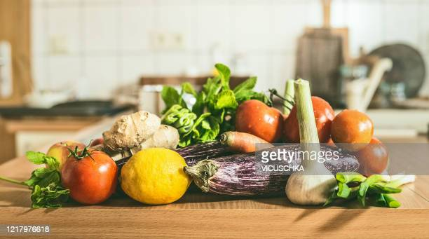 various vegetables cooking ingredients on kitchen table at cuisine  background . healthy cooking and eating - légumes photos et images de collection