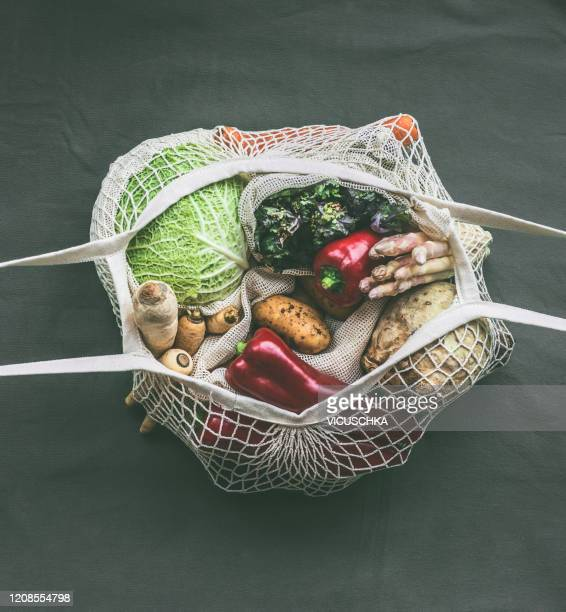 various vegetables in eco friendly mesh bags. top view - tessuto a rete foto e immagini stock