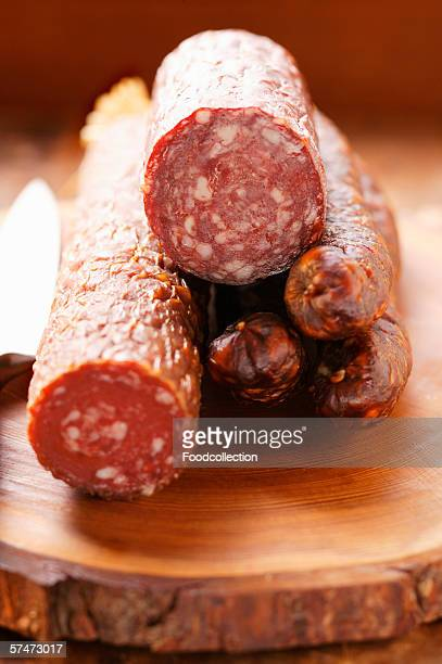 Various venison sausages on wooden plate