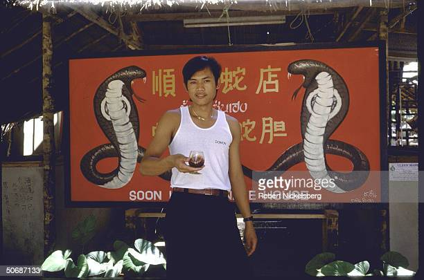 Various views of men mixing snake blood and gall bladder with Thai whiskey and Chinese herbs to make aphrodisiacs rheumatism cure and skin enriching...