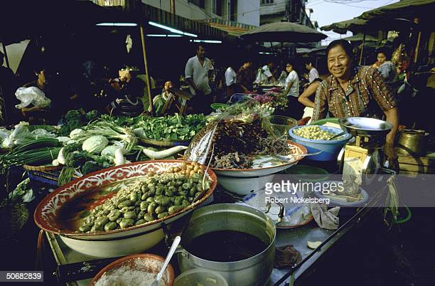 Various views of the outdoor Din Daeng market in the Chinatown section of the city of Bangkok