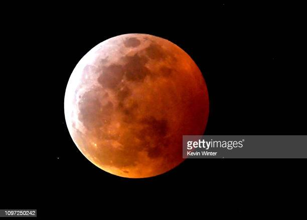 Various views of the Super Blood Wolf Moon eclipse on January 20 2019 in Burbank United States Overnight in the northern hemisphere a phenomenon...