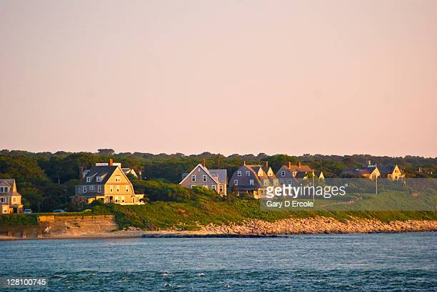 Various waterfront homes at sunset along coast in Woods Hole, Cape Cod, MA