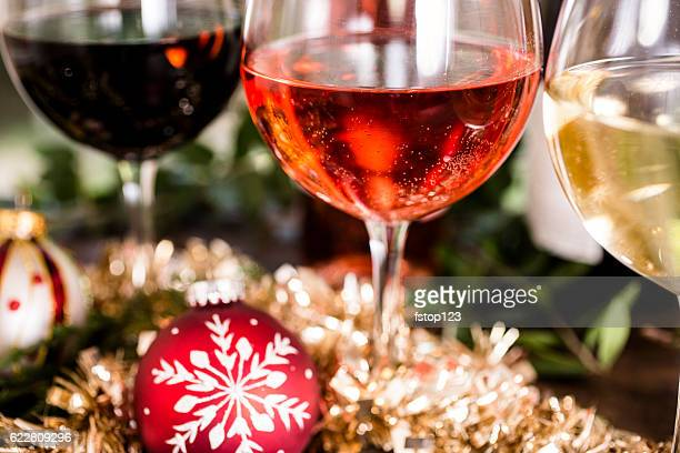 various wines in glasses on dining table at christmas. - tinsel stock pictures, royalty-free photos & images