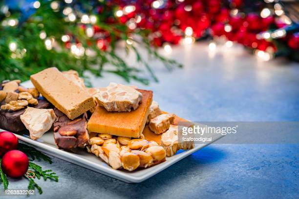variout types of spanish turron on christmas table - nougat stock pictures, royalty-free photos & images