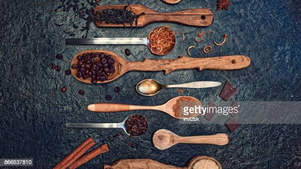 Variuos spoons with coffee, tea and spices