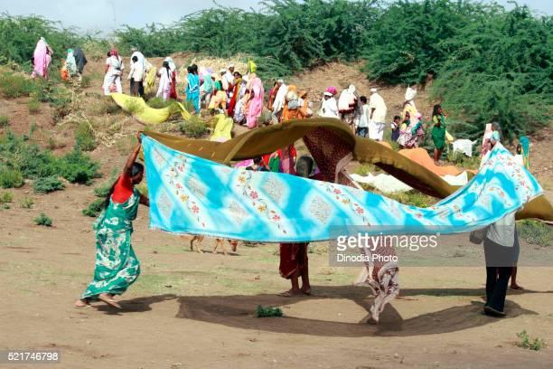 Varkari gathered at Chandrabhaga river on occasion of Ashadhi Ekadashi at Pandharpur town, district Solapur, state Maharashtra