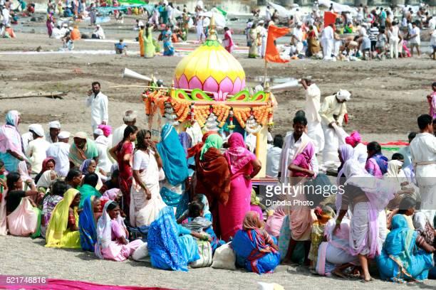 Varkari gathered at on bank Chandrabhaga river on occasion Ashadhi Ekadashi at Pandharpur town, Solapur, Maharashtra