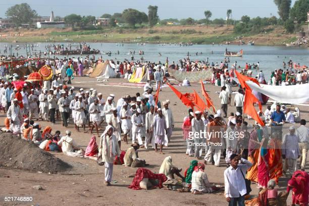 Varkari gathered at on bank of Chandrabhaga river on occasion of Ashadhi Ekadashi at Pandharpur town, Solapur, Maharashtra