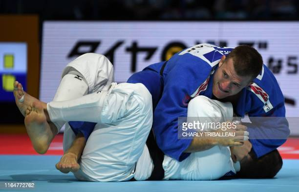 Varlam Liparteliani of Georgia fights in the repechage match against Michael Korrel of Netherlands in the men's under 100kg category during the 2019...