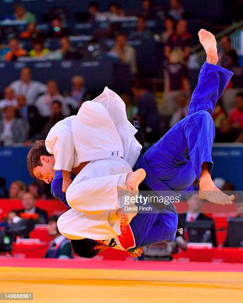 Varlam Liparteliani of Georgia throws Mark Anthony of Australia for a small score during the Men's 90 kg Judo on Day 5 of the London 2012 Olympic...