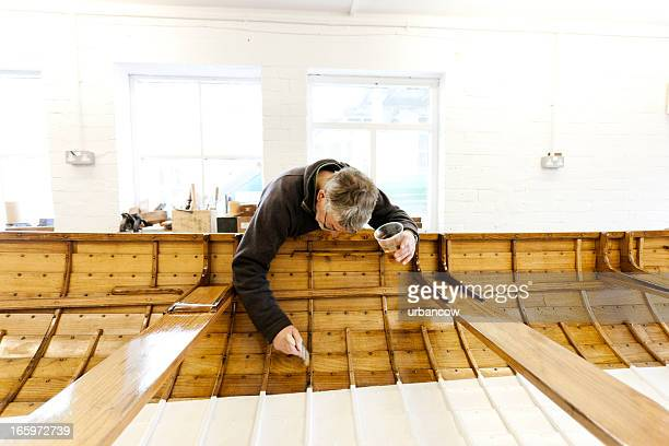 Varnishing a gig boat