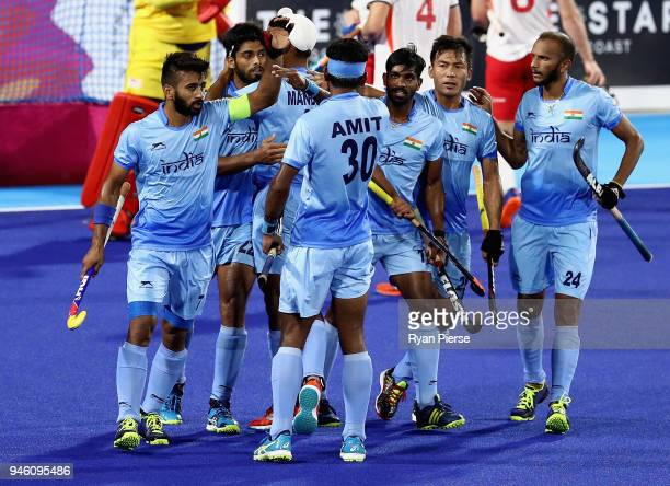 Varun Kumar of India celebrates scoring his sides first goal with team mates in the Men's bronze medal match between England and India during Hockey...