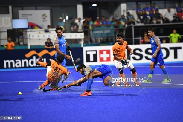 Varun Kumar of India shoots during Men's Hockey Semifinal match between Malaysia and India at GBK Senayan on day twelve of the Asian Games on August...