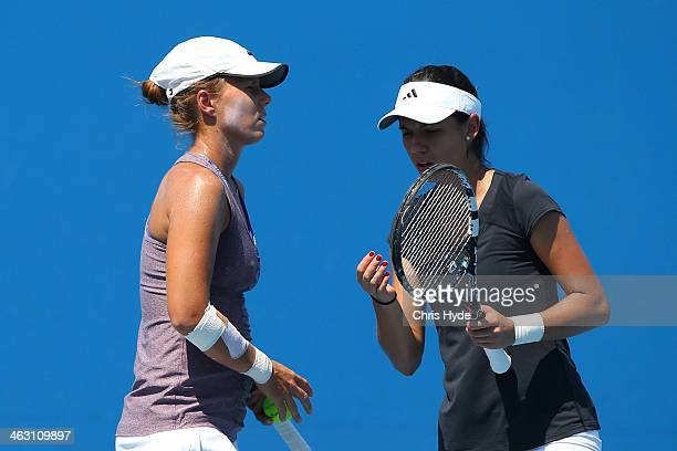 Varvara Lepchenko of the United States and Raluca Olaru of Romania talk tactics in her second round women's doubles match against Hao-Ching Chan of...