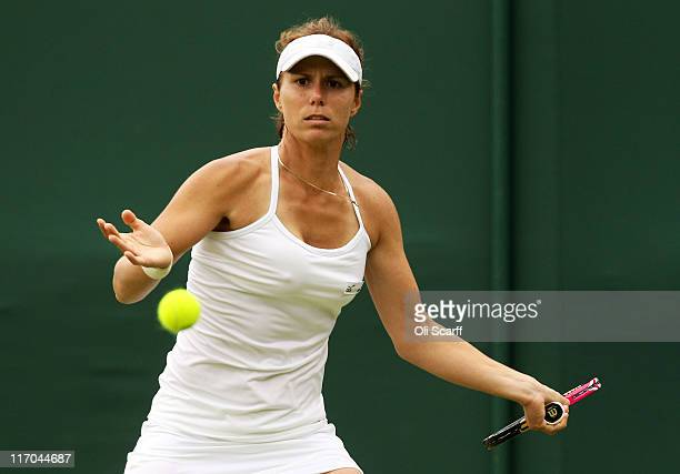 Varvara Lepchenko of the United States lines up a shot during her first round match against Yanina Wickmayer of Belgium on Day One of the Wimbledon...