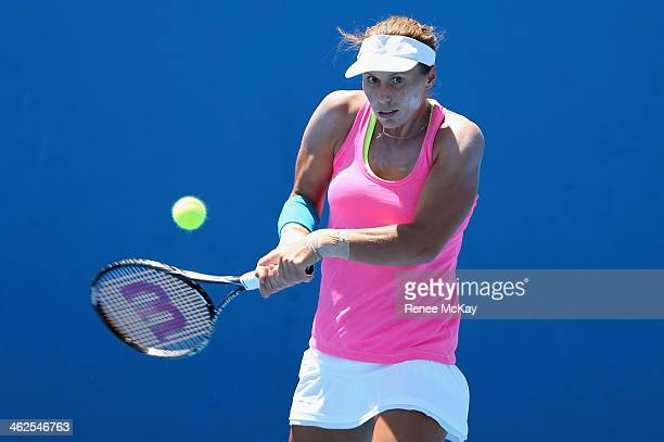 Varvara Lepchenko of the United States plays a backhand in her first round match against Lesia Tsurenko of the Ukraine during day two of the 2014...