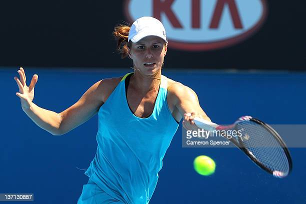 Varvara Lepchenko of the United States plays a forehand during her first round match against Daniela Hantuchova of Slovakia during day one of the...