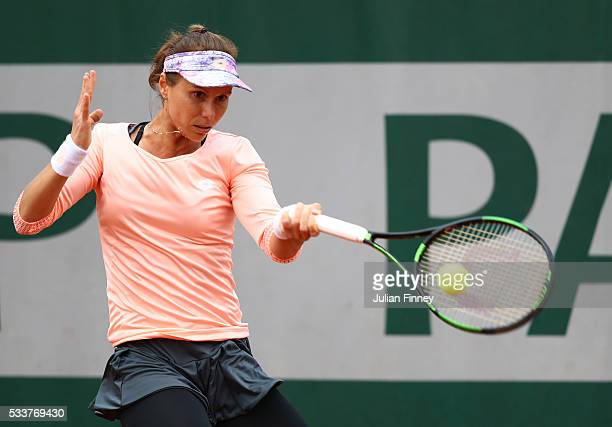 Varvara Lepchenko of the United States plays a forehand during the Women's Singles first round match against Ekaterina Makarova of Russia on day two...