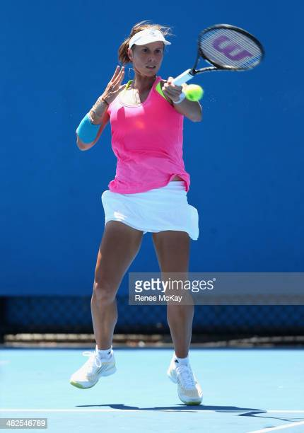 Varvara Lepchenko of the United States plays a forehand in her first round match against Lesia Tsurenko of the Ukraine during day two of the 2014...