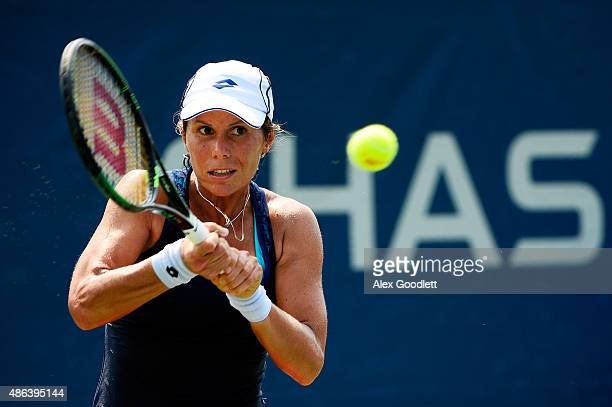 Varvara Lepchenko of the United States returns a shot against Lesia Tsurenko of Ukraine during their Women's Singles Second Round match on Day Four...