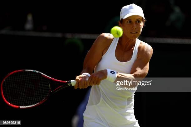 Varvara Lepchenko of the United States returns a shot against Caroline Wozniacki of Denmark during their Ladies' Singles first round match on day one...