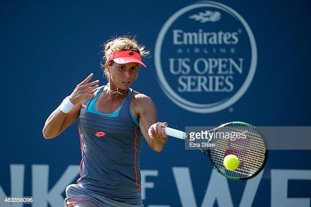 Varvara Lepchenko of the United States returns a shot to Mona Barthel of Germany during Day 5 of the Bank of the West Classic at Stanford University...