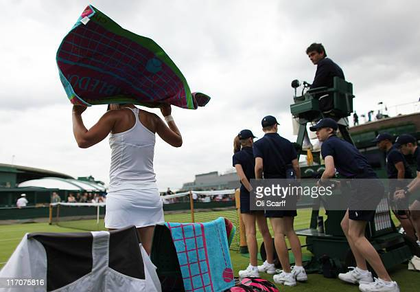 Varvara Lepchenko of the United States towels off during her first round match against Yanina Wickmayer of Belgium on Day One of the Wimbledon Lawn...