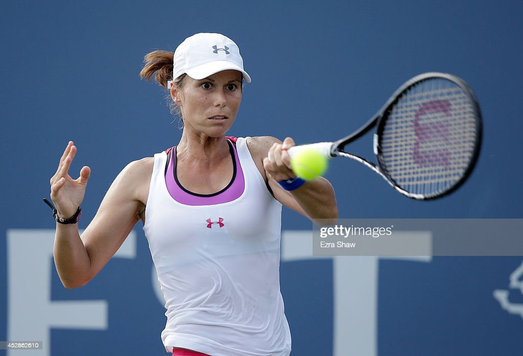 Varvara Lepchenko of the USA returns a shot to Caroline Garcia of France during Day 1 of the Bank of the West Classic at the Taube Family Tennis Stadium on July 28, 2014 in Stanford, California.