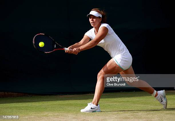 Varvara Lepchenko of USA hits a backhand return during her Ladies' Singles second round match against Anastasia Pavlyuchenkova of Russia on day four...