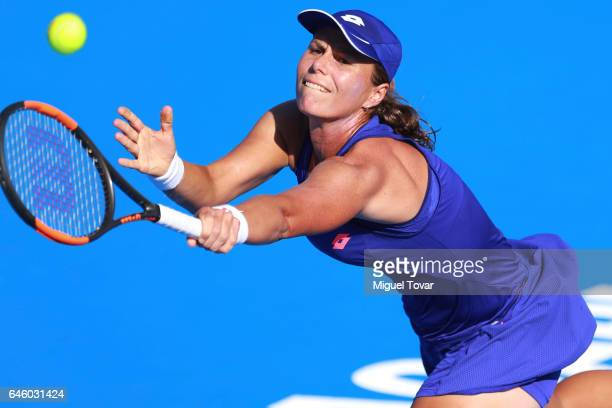 Varvara Lepchenko of USA takes a backhand shot during a first round match between Kristina Mladenovic of France and Varvara Lepchenko of USA as part...