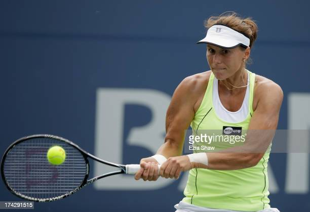 Varvara Lepchenko returns a shot to Michelle Larcher De Brito of Portugal during their match on Day 2 of the Bank of the West Classic at Stanford...