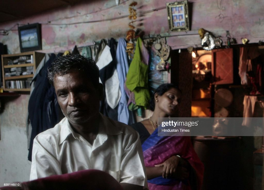 Vasanth Anna Landge is seen mourning after cremating his nine year old daughter, Kajal and wife Vijaya in 30/6 heavy raining.
