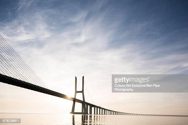 Vasco Da Gama Bridge against dramatic sky, Tagus River, Lisbon, Portugal