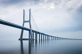 Vasco da Gama Bridge at sunrise in Lisbon, Portugal. he longest bridge in Europe