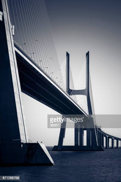 vasco da gama contemporary architecture cable-stayed bridge, lisbon, portugal - suspension bridge stock photos and pictures