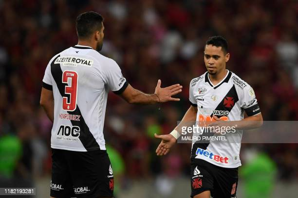 Vasco da Gama player Yago Pikachu celebrates with a teammate after scoring against Flamengo during a 2019 Brazilian Championship football match at...