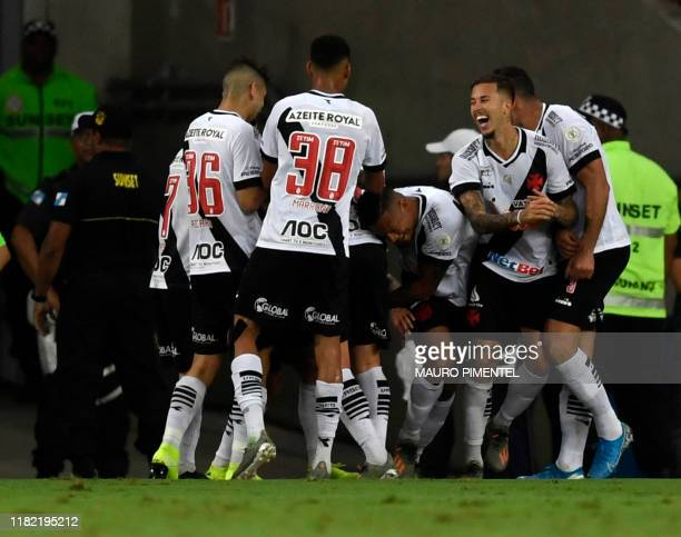 Vasco da Gama player Yago Pikachu celebrates with teammates after scoring against Flamengo during a 2019 Brazilian Championship football match at the...
