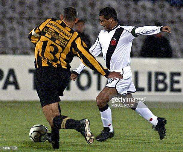 Vasco Da Gama Romario fights for the ball with player of Penarol Aguirregaray 02 May 2001 in Montevideo AFP PHOTO/Miguel ROJO