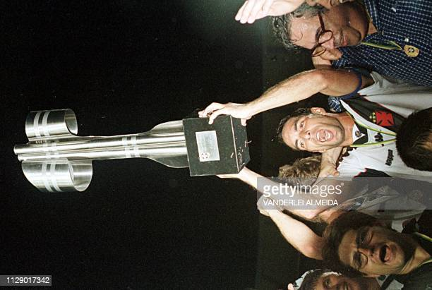 Vasco da Gama's captain Edmundo holds the trophy after his team won the Brazilian soccer championship 21 December at Maracana Stadium in Rio de...
