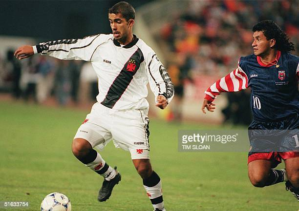 Vasco da Gama's Felipe dribbles past DC United's Marco Etcheverry during the Interamerican Cup match 14 November at RFK Stadium in Washington DC...